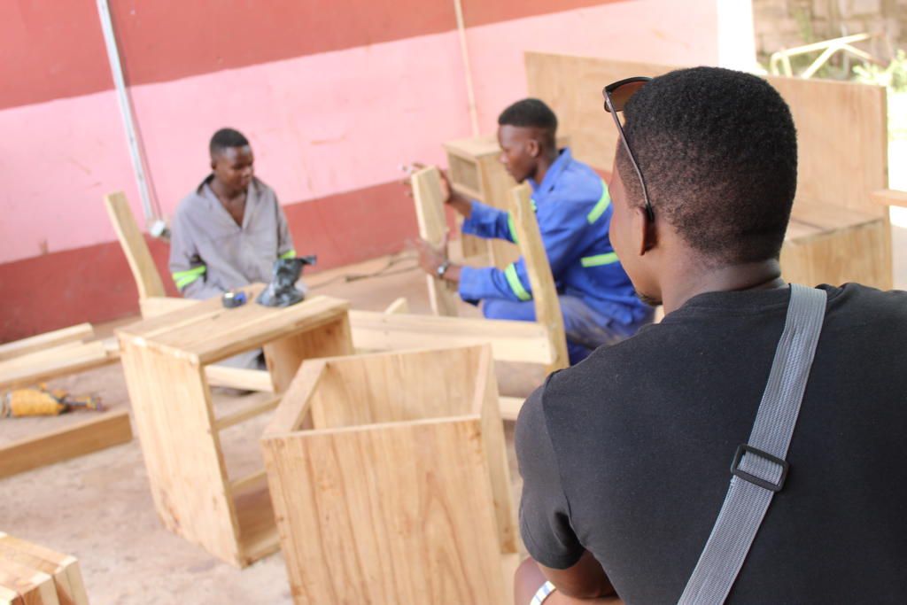 Joseph Mushunge took the final exam for his carpentry course